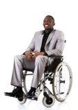 Homem de negócios deficiente que senta-se na cadeira de rodas Imagens de Stock