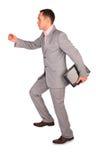 Homem de negócios dinâmico com caderno Imagem de Stock Royalty Free