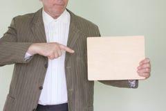 Homem de negócios do conceito do negócio Guarda um vazio imagem de stock