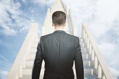 Homem de negócios do conceito do sucesso em escadas Imagens de Stock Royalty Free