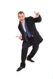 Homem de negócios do sorriso dos jovens nos dedos pointed do revestimento Imagem de Stock Royalty Free