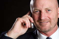 Homem de negócios do telefone de pilha Fotografia de Stock