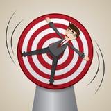Homem de negócios dos desenhos animados fechado no alvo de giro Fotos de Stock