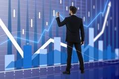 Homem de negócios e carta do mercado de valores de ação Fotografia de Stock Royalty Free