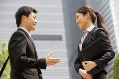 Homem de negócios e mulher de negócios chineses Fotografia de Stock