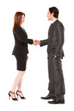 Homem de negócios e mulher de negócios que agitam as mãos Imagens de Stock