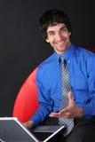 Homem de negócios e portátil fotografia de stock