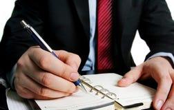 Homem de negócios e uma agenda fotografia de stock