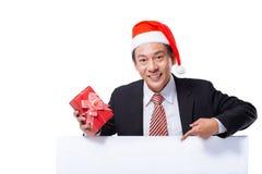 Homem de negócios em um chapéu de Santa Claus Imagem de Stock