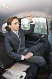 Homem de negócios em um táxi imagem de stock royalty free