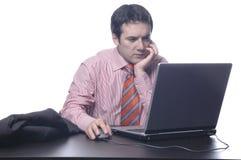 Homem de negócios em um terno atrás da fotografia de stock royalty free