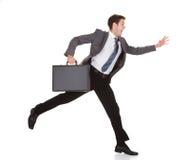 Homem de negócios em uma pressa Imagem de Stock Royalty Free