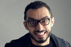 Homem de negócios engraçado com expressão louca isolado Fotos de Stock