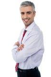 Homem de negócios envelhecido meio de sorriso fotografia de stock