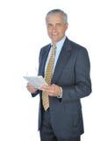 Homem de negócios ereto com o jornal isolado fotos de stock royalty free
