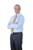 Homem de negócios ereto com os braços cruzados fotografia de stock