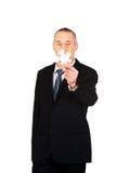 Homem de negócios esperto que guarda um enigma Fotografia de Stock Royalty Free