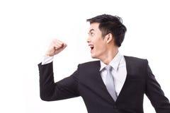 Homem de negócios excitado, bem sucedido, forte que olha acima imagem de stock royalty free