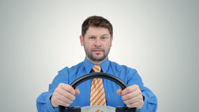 Homem de negócios farpado com um volante foto de stock