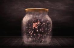 Homem de negócios fechado em um frasco com conceito dos pontos de interrogação Imagem de Stock Royalty Free