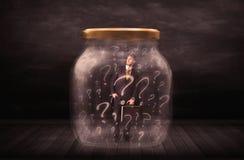Homem de negócios fechado em um frasco com conceito dos pontos de interrogação Foto de Stock Royalty Free