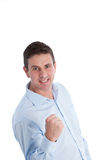 Homem de negócios feliz Clenching seu punho para o sucesso fotografia de stock