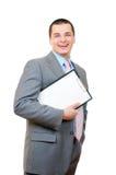 Homem de negócios feliz com uma prancheta Fotos de Stock