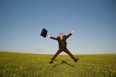 Homem de negócios feliz de salto Imagem de Stock