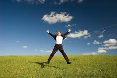 Homem de negócios feliz de salto Imagens de Stock