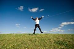 Homem de negócios feliz de salto Fotos de Stock