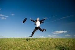 Homem de negócios feliz de salto Fotografia de Stock