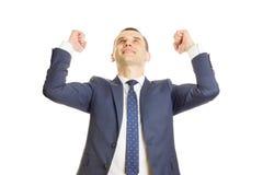 Homem de negócios feliz em uma pose da vitória Fotos de Stock Royalty Free