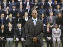 Homem de negócios In Front Of Multiethnic Executives imagem de stock