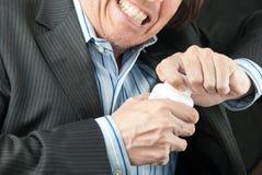 Homem de negócios frustrante que tenta abrir o frasco do comprimido Foto de Stock Royalty Free