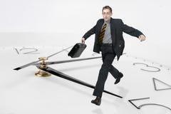Homem de negócios funcionado através do ti Fotografia de Stock Royalty Free