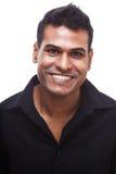 Homem de negócios indiano novo com sorriso de acolhimento imagem de stock royalty free
