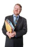 Homem de negócios interessado com dobradores - no branco Fotos de Stock Royalty Free