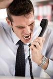 Homem de negócios irritado Fotografia de Stock Royalty Free