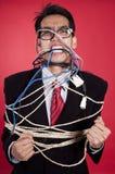 Homem de negócios irritado amarrado toda acima Fotografia de Stock