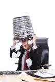 Homem de negócios irritado com o escaninho dos desperdícios em sua cabeça fotografia de stock royalty free