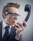 Homem de negócios irritado do lerdo Foto de Stock