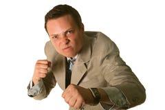 Homem de negócios irritado isolado no branco Fotografia de Stock Royalty Free