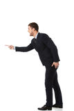 Homem de negócios irritado que aponta à esquerda Imagem de Stock Royalty Free