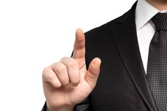 Homem de negócios isolado em um terno e em pontos o dedo em um objec foto de stock