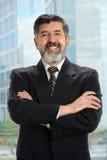Homem de negócios latino-americano Near Window Fotografia de Stock Royalty Free