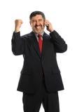 Homem de negócios latino-americano que comemora Imagens de Stock