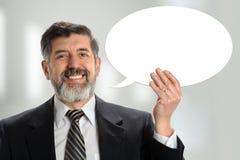 Homem de negócios latino-americano With Sign Fotos de Stock Royalty Free