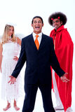 Homem de negócios louco com anjo e demónio fotos de stock royalty free