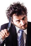 Homem de negócios louco da lâmina da garganta do corte Foto de Stock