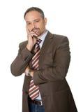 Homem de negócios maduro pensativo no fundo branco imagem de stock
